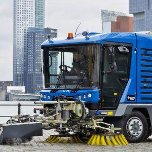 Blue Ravo 5-iSeries Street Sweeper Along Port