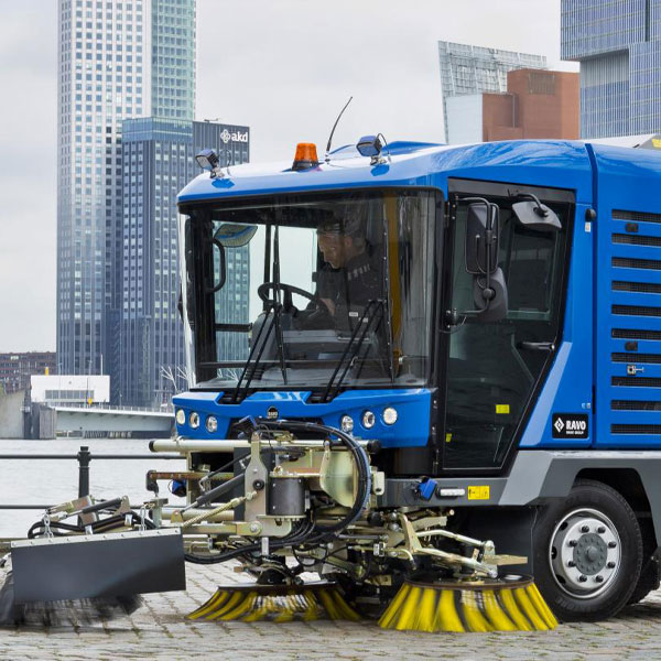 Blue Ravo 5-iSeries Street Sweeper Along Port