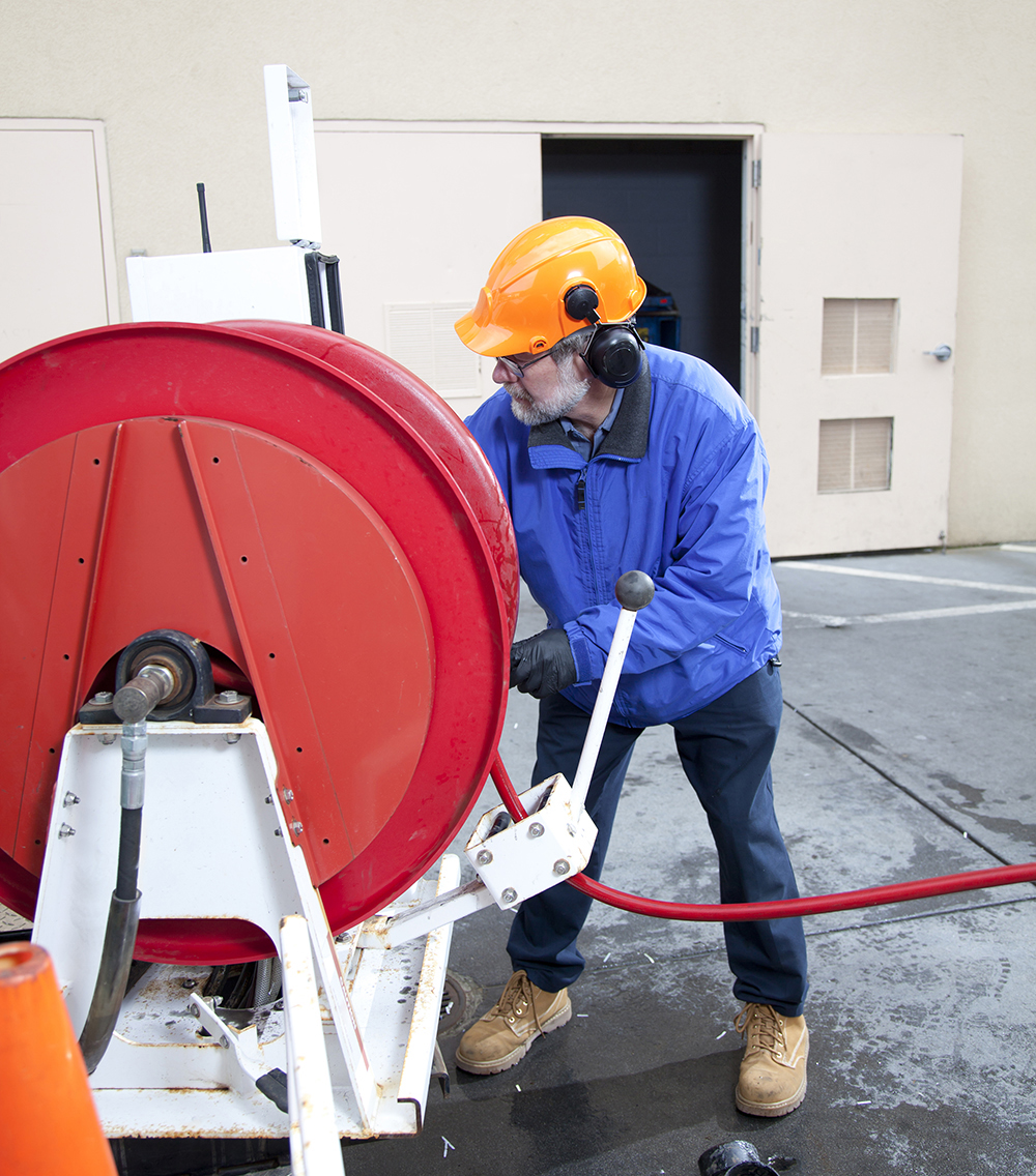 A man Hydro Line Jetting a Pipe