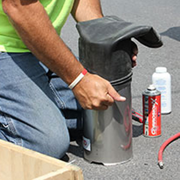 Worker using the Quicklock Pipe Repair System