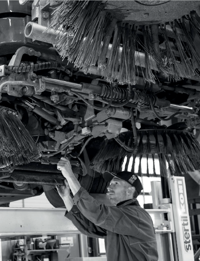 Parts Technician working on a Sweeper Truck